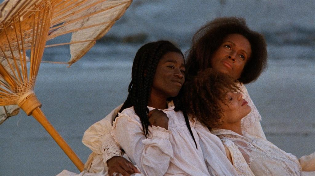 "A film still of three women from Julie Dash's acclaimed film, ""Daughters of the Dust."""