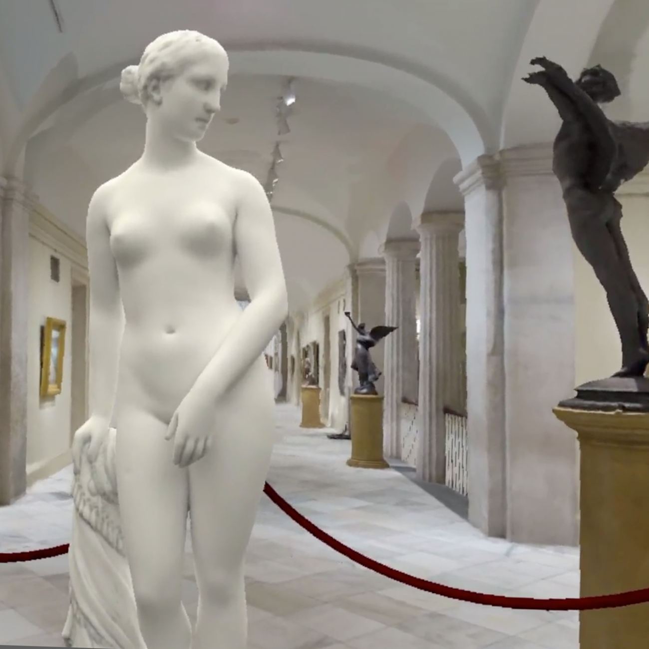 A white sculpture of a naked woman standing.