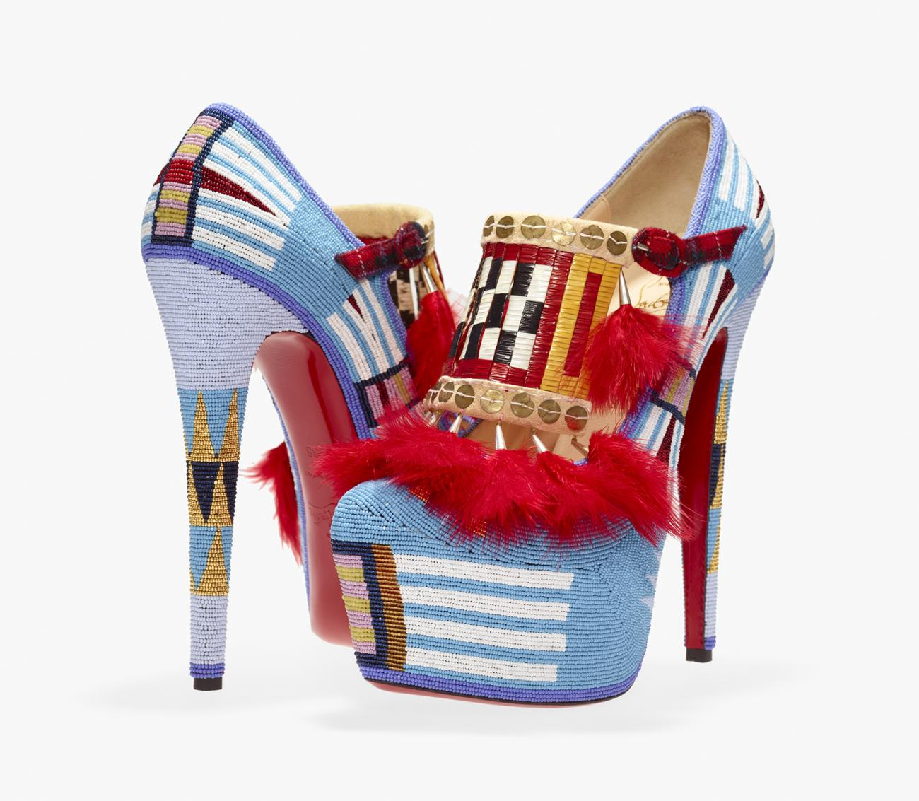 Two high heel shoes made fro beads, sequins, feathers and other items.