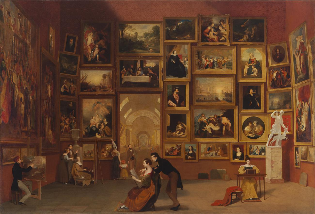 A room with many framed artworks on the walls.