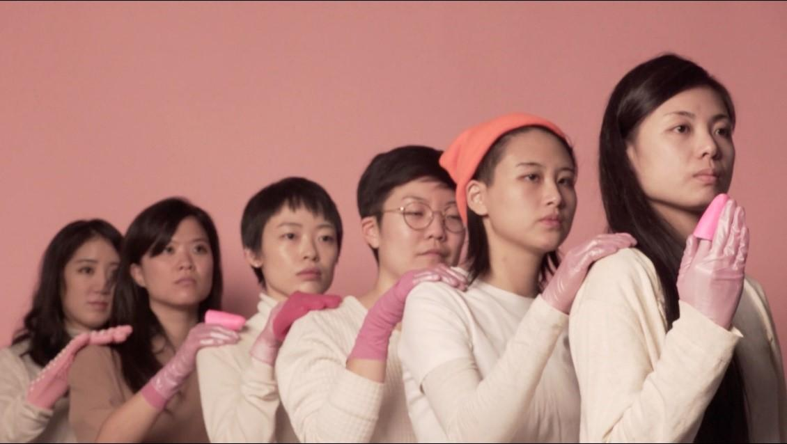 An image of six women each with a hand filled with pink slime