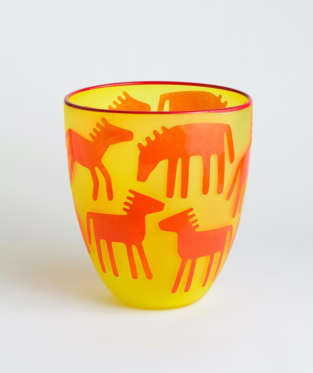 Yellow and Orange Glass Cup with Horses and Deer on it.