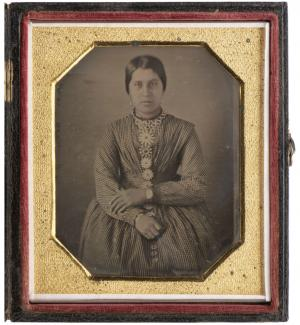 A photo of a Haudenosaunee Iroquois woman in a gold frame
