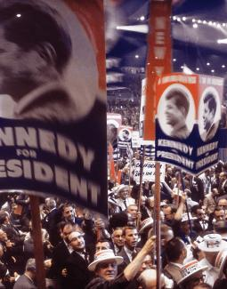Crowd of people holding Kennedy for President signs