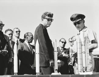 JFK next to a row of model rockets
