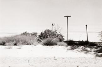 A photograph of a California landscape by automobile.