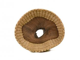 A basket with a white oak and walnut center.