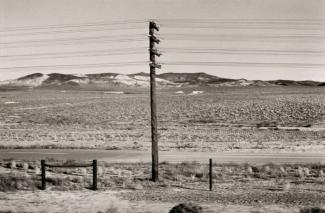 A photograph of a Nevada landscape by automobile.