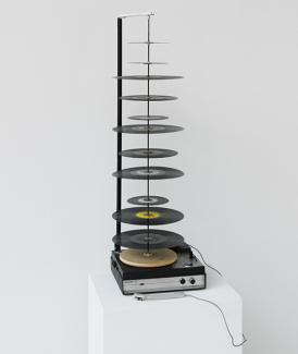 Name June Paik's Random Access made from record player with lengthened axis.