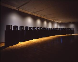 Name June Paik's TV Clock made from color television monitors mounted on twenty-four pedestals.