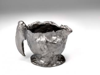 This is Jeffrey Clancy's Creamer with Lobster Claw and Concealed Decoration made from stainless steel for 40 Under 40 at the Renwick Gallery.