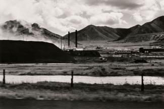 A photograph of a Utah landscape with mountains by automobile.