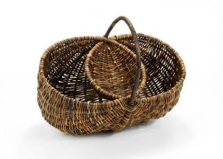 A basket that looks like two separate circular shapes merged together with a handle.