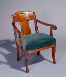 A walnut Grecian style armchair.