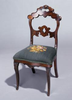 A mahogany French style side chair.