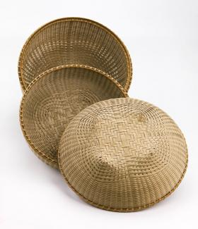 Three baskets that are circular.