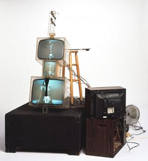 Name June Paik's TV Cello made from plexiglas boxes, wiring, wood, fan.