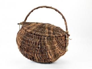 A basket with a circular base and handle.