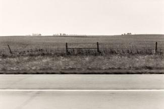 A photograph of a Iowa landscape taken by automobile.