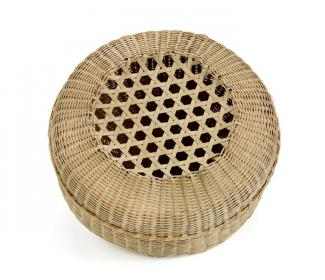 A basket with a circular base and lid with holes in the top.