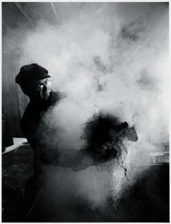 Black and White photograph of Wayne Higby in studio firing work.