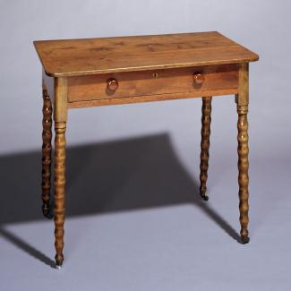 A walnut, maple, and yellow pine Cottage style dressing table.