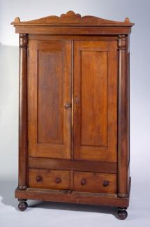 A poplar and yellow pine Classical style wardrobe.
