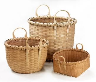Three baskets of different heights that all have two round circle handles.