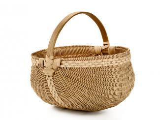 A basket shaped like a melon with a handle.
