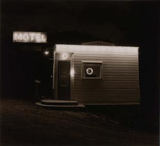 A photograph of a motel in South Dakota taken at night.