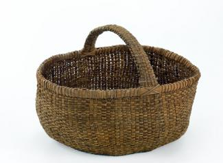 A basket that has circular shape with a handle.