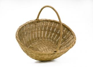 A basket that has a small circular base with it's body flaring our to a larger circle with a long handle.