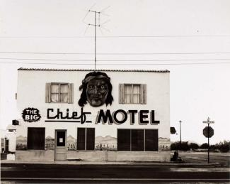 A photograph of the exterior or a motel in Arizona.