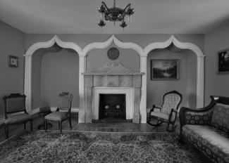 A photograph inside a parlor.