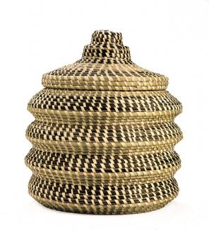 A basket with four undulating sides and a lid.