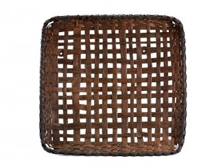 A basket that is square with a loose weave allowing for openings.