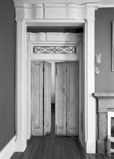A photograph of a doorway with double swinging doors.