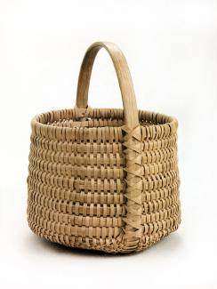 A basket that's small and deep with a circular shape and a handle.