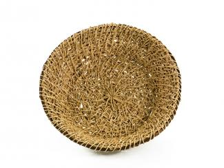 A basket that resembles a large bowl made from thin honeysuckles vine.