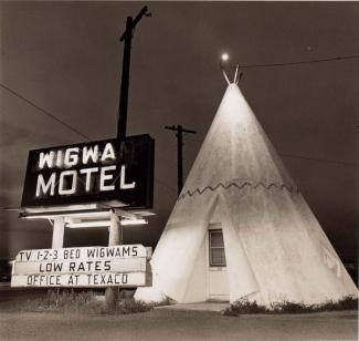 A photograph of a motel in Arizona with a teepee outside.