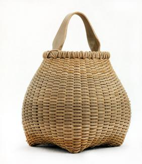 A basket that has a square base and flares out with a small circular top with a handle.