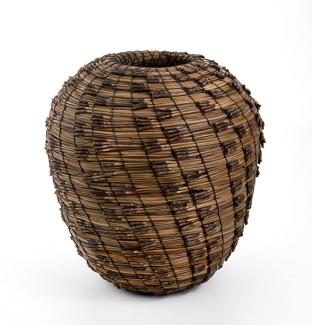 A basket that is long with a small top and bottom that flares out in the middle.