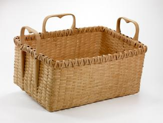 A basket that is rectangular with three heart shaped handles.