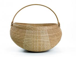 A basket with a half circle shape with a circle handle.