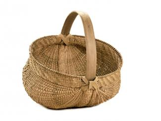 A basket that's short with a circular base and handle.