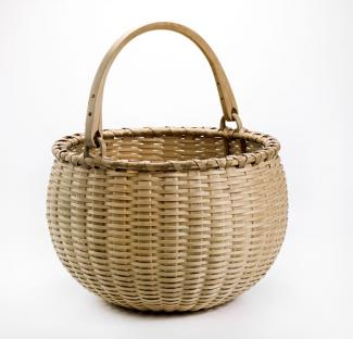 A basket that's perfectly circular with a handle.