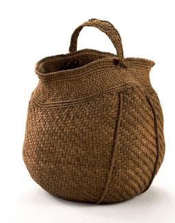A basket that is circular with a shape that looks to be malleable.