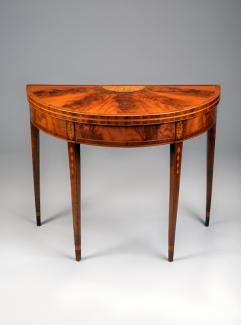 An image of a card table made from mahogany.
