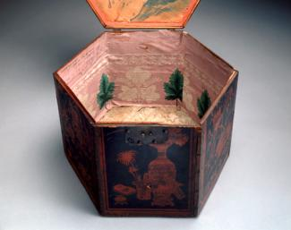An image of a painted wood box with wallpaper inside of it.