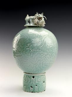 An image of Lee's porcelain object with a dragon embedded in the mold and placed on top.